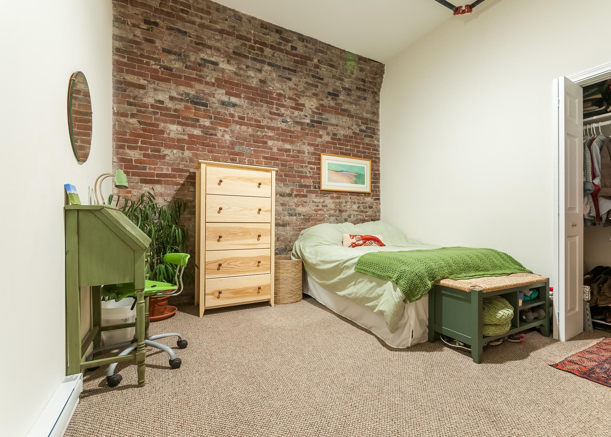 original brick wall in bedroom